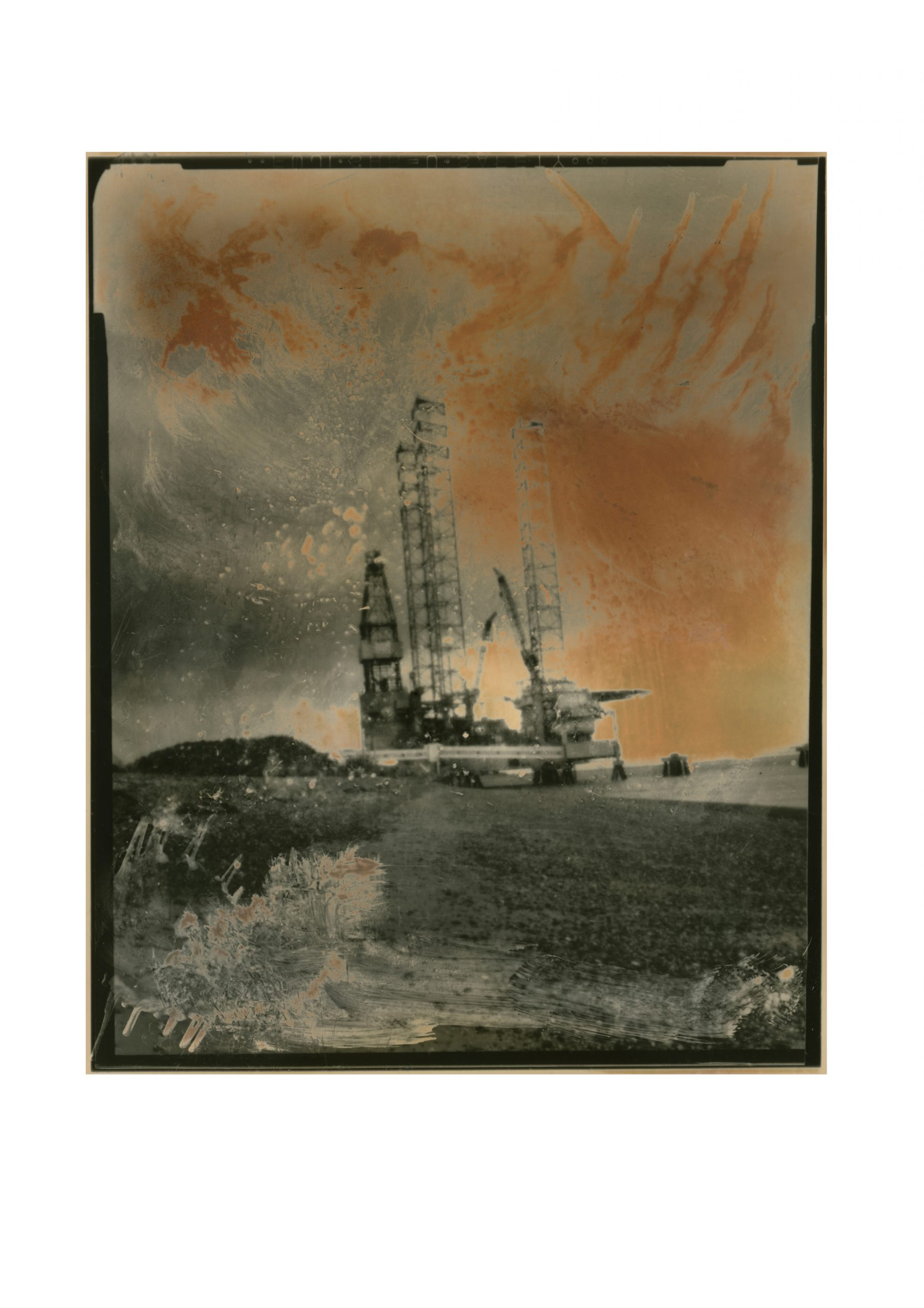 quite abstract image of what appears to be an old sailing ship but is an oil rig under construction foreground greys and washed in sky is a rusted looking orange