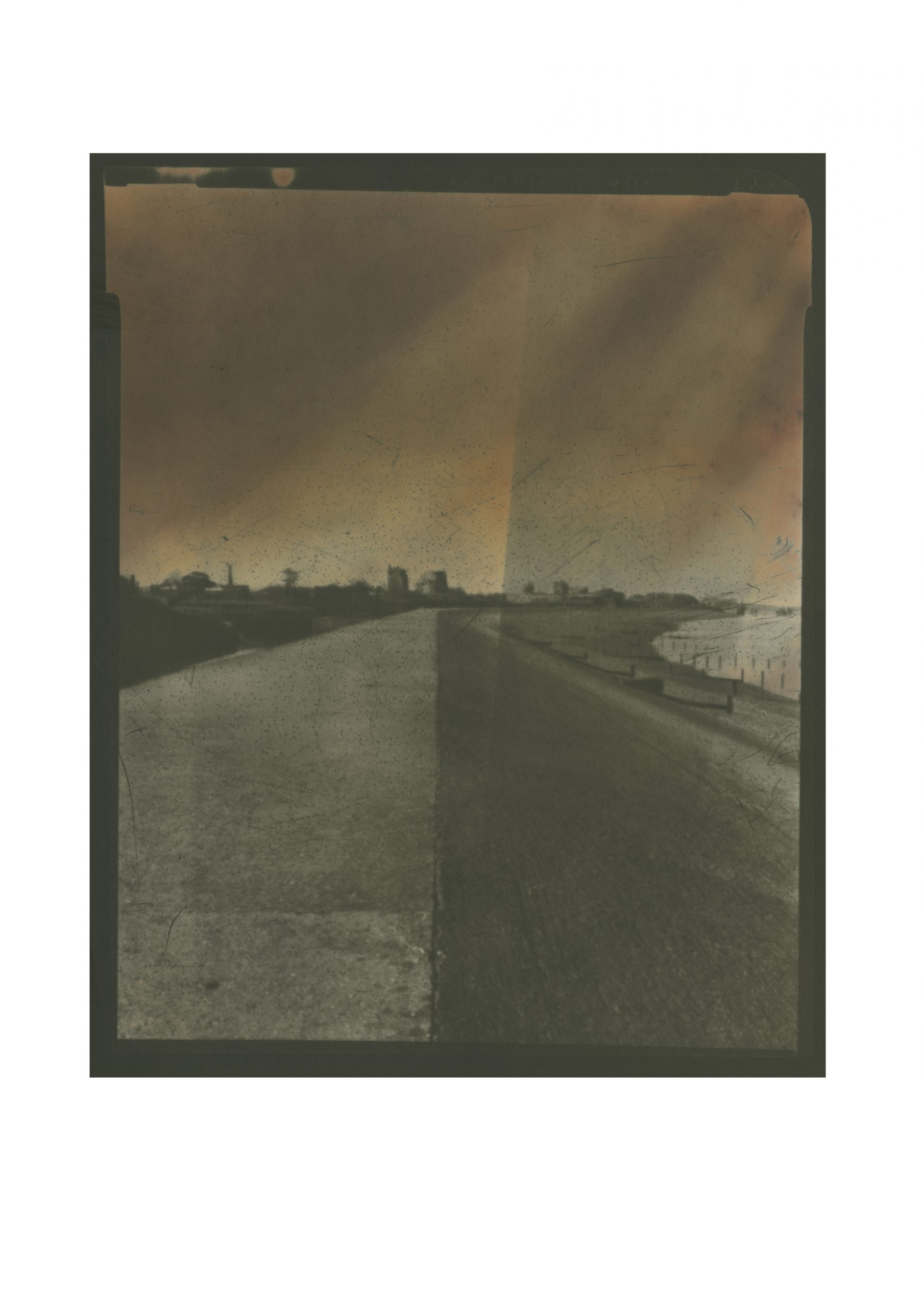 Brooding dark image with hint of orange skies defences leading to a vanishing point